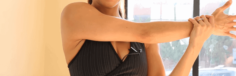 Woman stretching her right arm