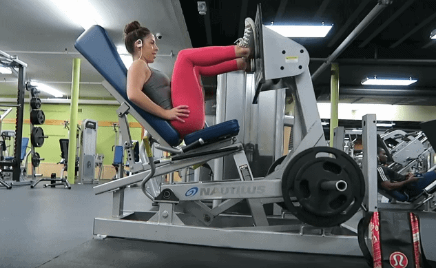 Woman exercising on an exercise equipment in the gym