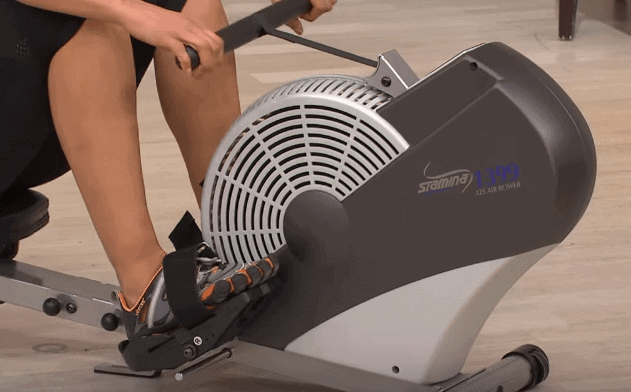 Person on a rowing machine