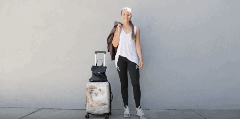 Woman with a travel luggage