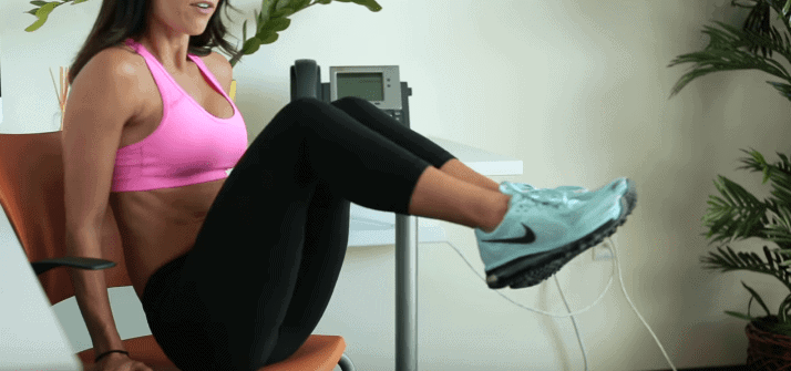 Woman exercising on an office chair