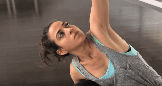 Woman looking serious while stretching