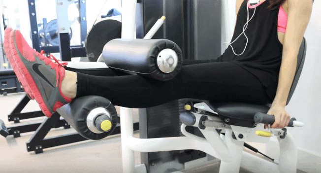 Woman working out on an exercise equipment in the gym