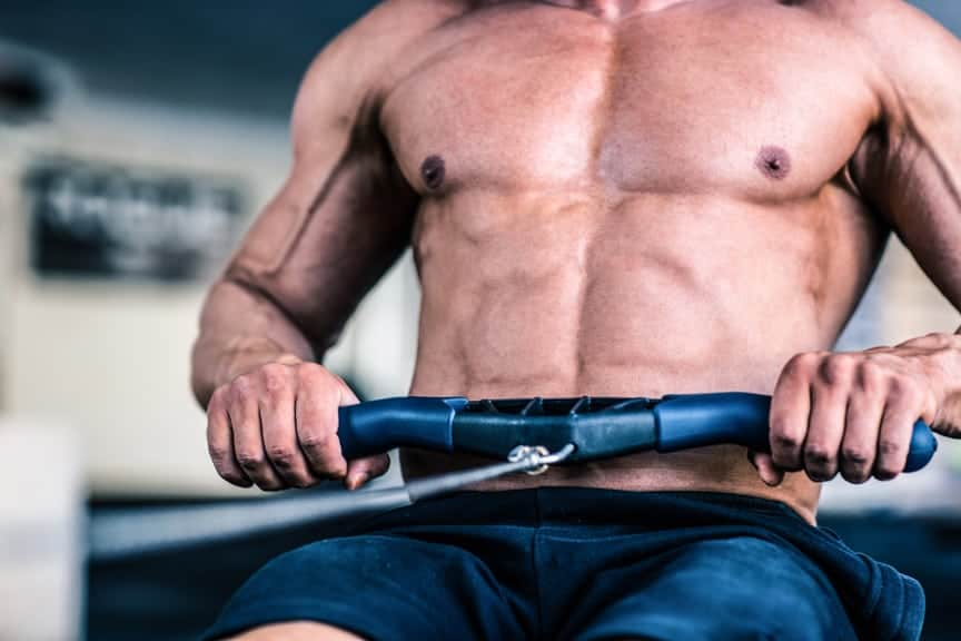 A man on a rowing machine (fitness equipment)