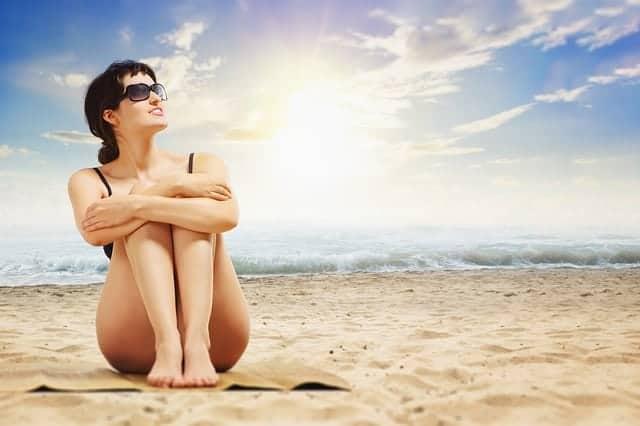Woman wearing sunglasses on a beach