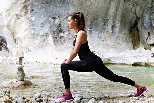 Woman stretching her leg outdoor
