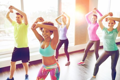 A group of people doing zumba