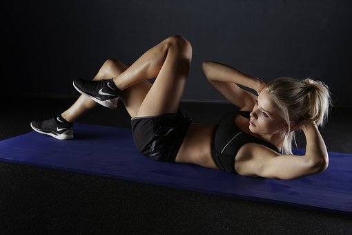Woman working out on a mat