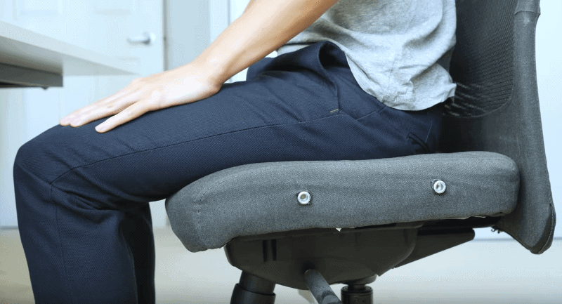 Side view of person sitting on an office chair