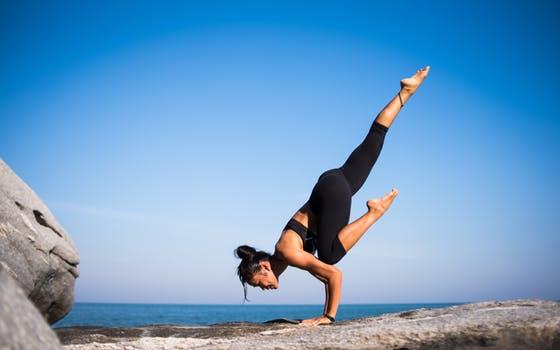 Woman doing handstand outdoor