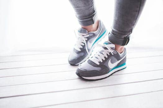 Close up shot of a woman's running shoes