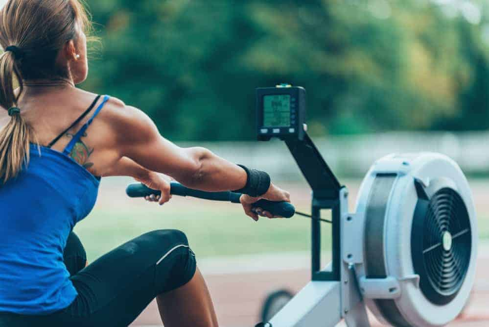 Woman rowing on a rowing machine