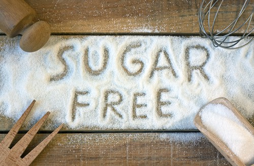 Spelled the words sugar free using sugar on wooden table