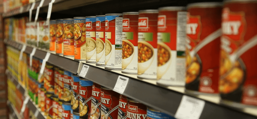 Canned foods on a shelf in a grocery store