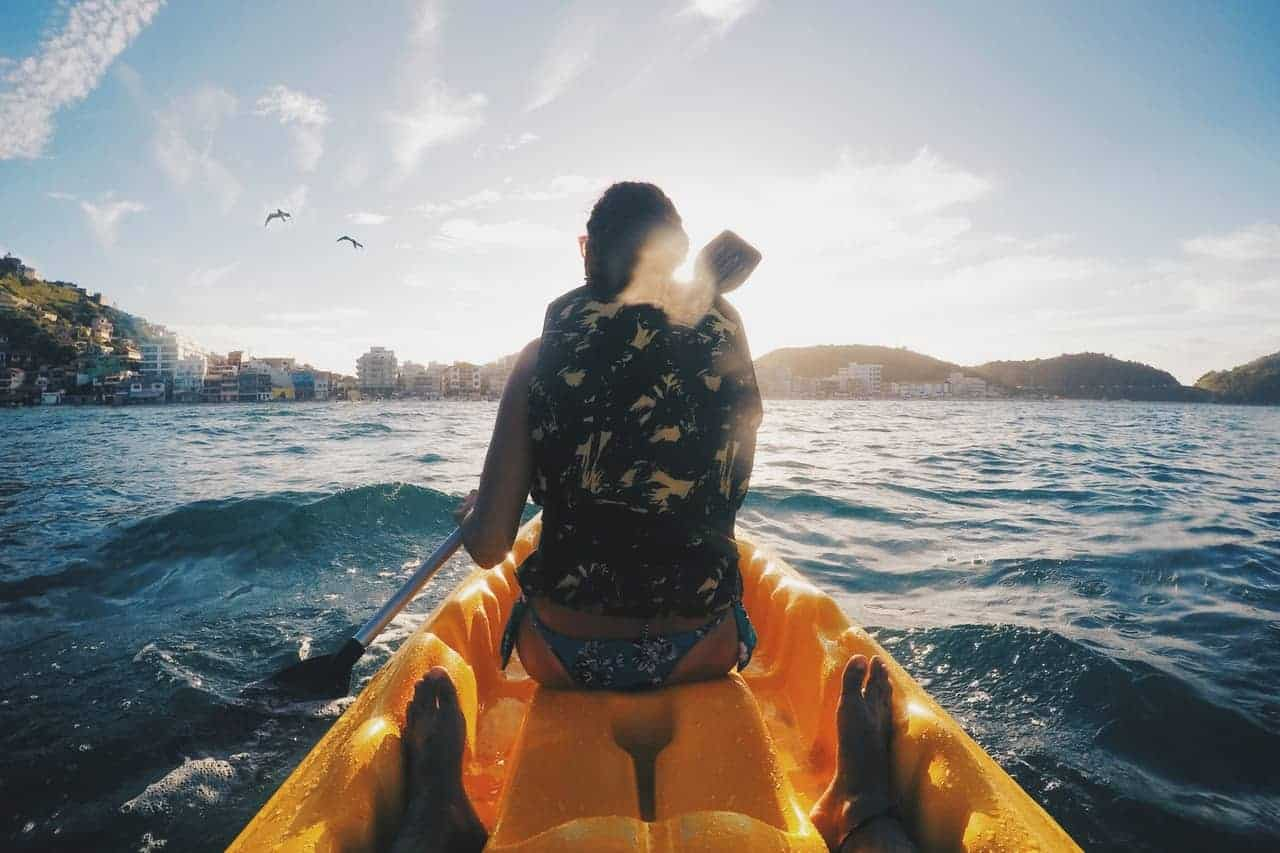 Back view of a woman kayaking