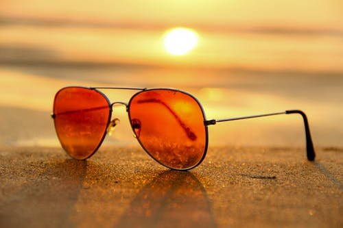 Sunglasses with a sunset background