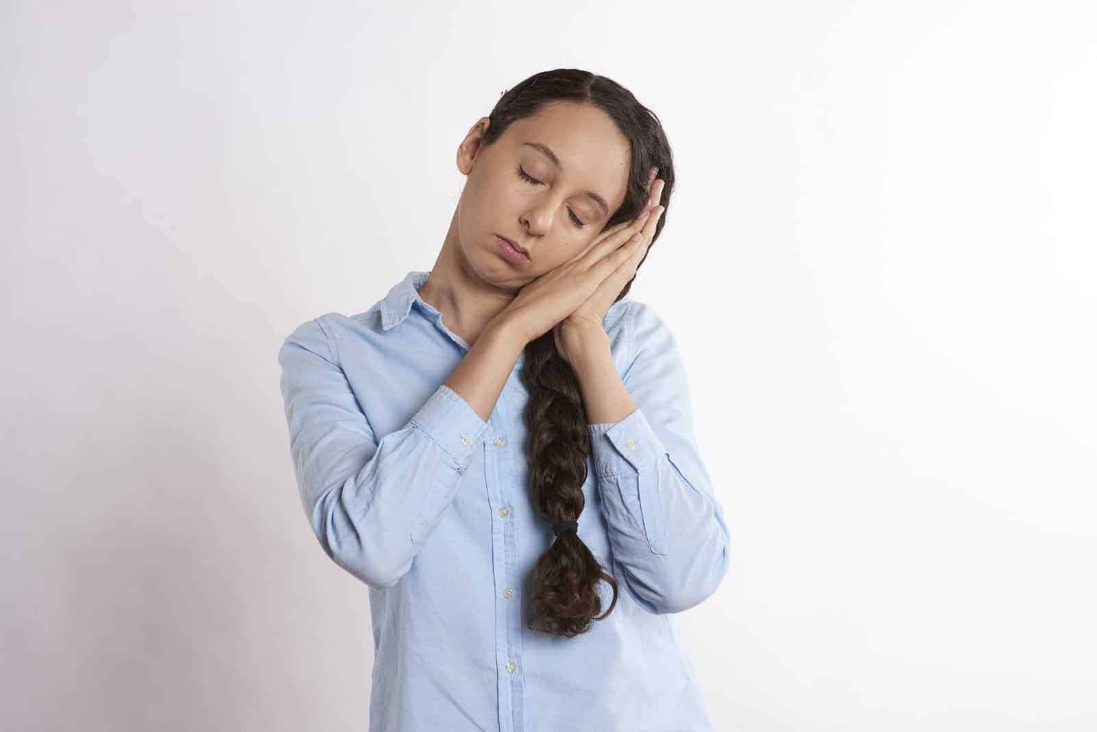 Woman posing a sleep gesture