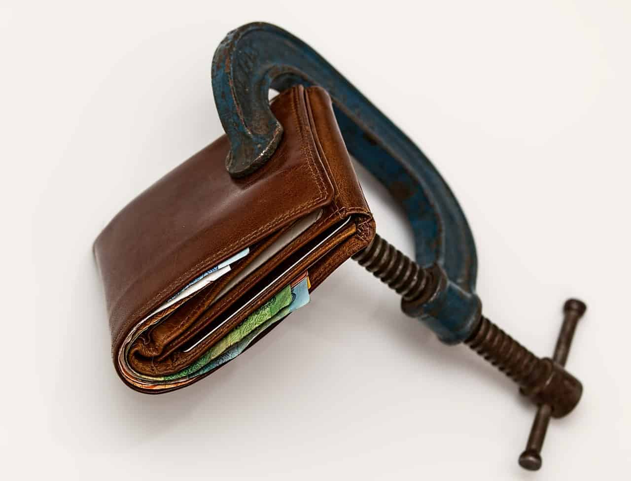 Wallet being clamped by a G clamp