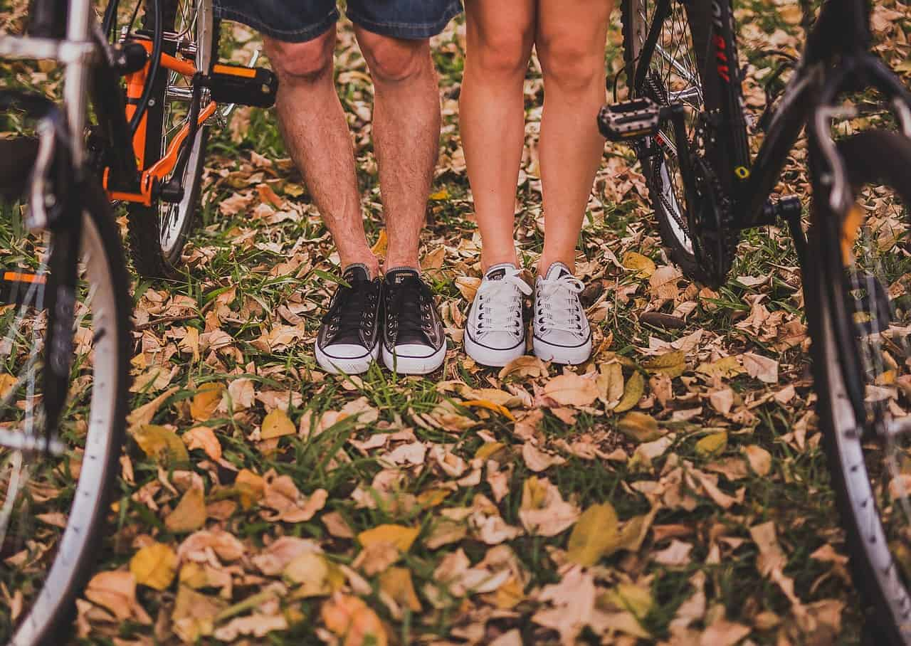Legs of a couple with bicycles