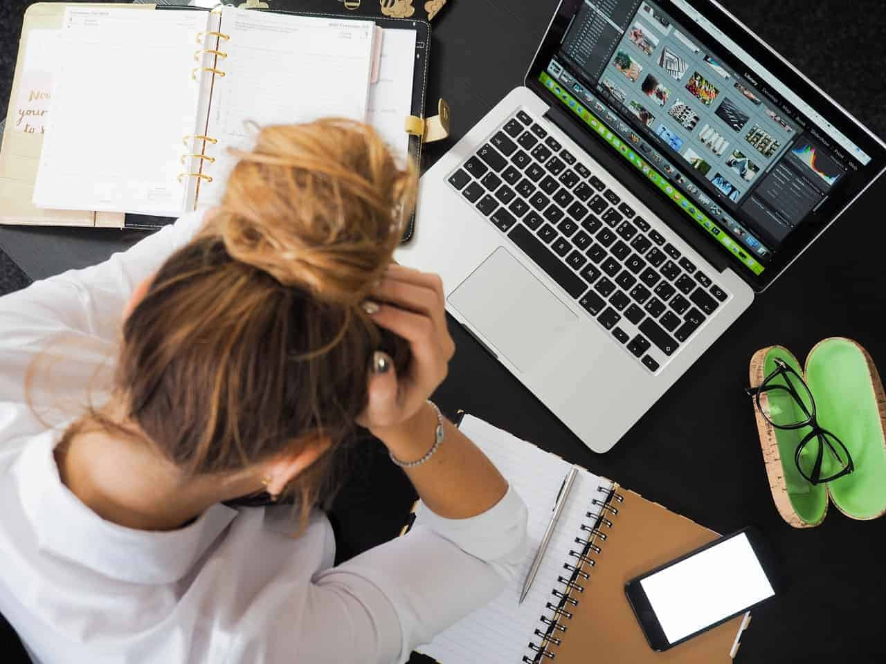 Stressed woman working on laptop