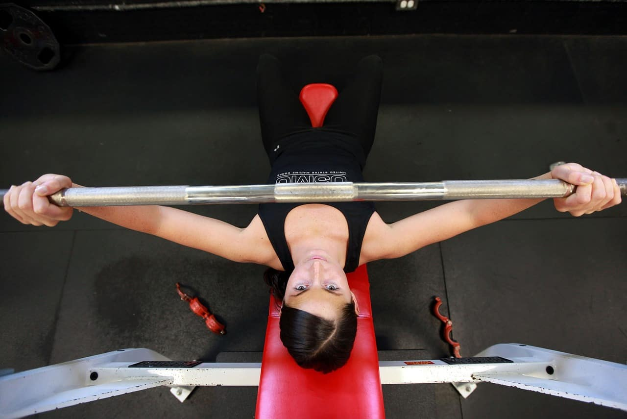 Top view of a woman holding a weight lifting bar