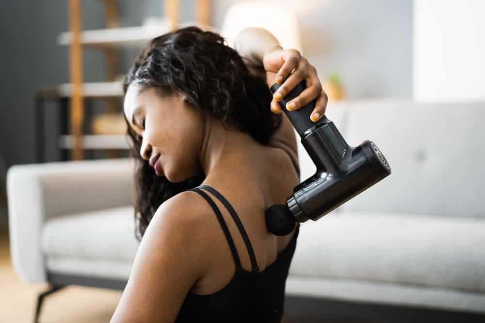 Health Constitution_Muscle Massage Gun on Upper Back